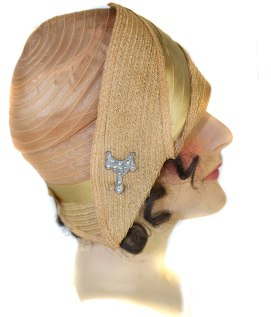Our French millinery mannequin models her 1928 summer horsehair hat trimmed with its original rhinestone brooch. Photograph by Julia Henri thegildedtimes.wordpress.com
