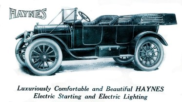 Illustrated advertisement for the upcoming 1913 Haynes gasoline motor vehicles with newly invented electric starters and lighting from Vogue Millinery Number, September 1, 1912.